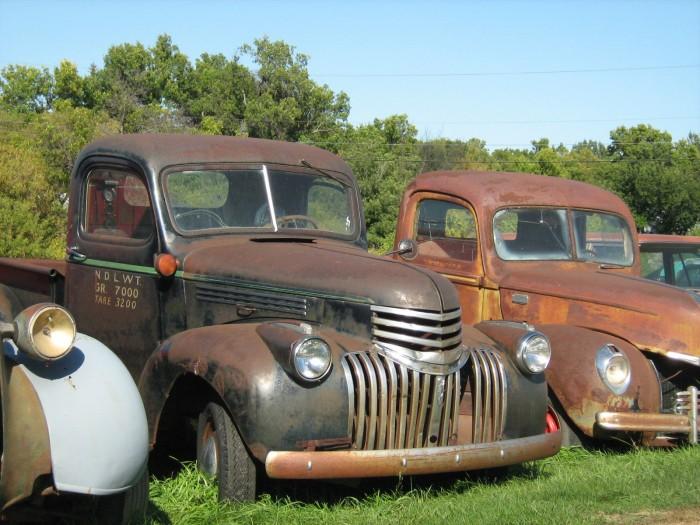 OilGard - image of rusty antique pick ups